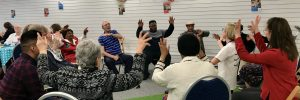 Older people exercising in an energetic session