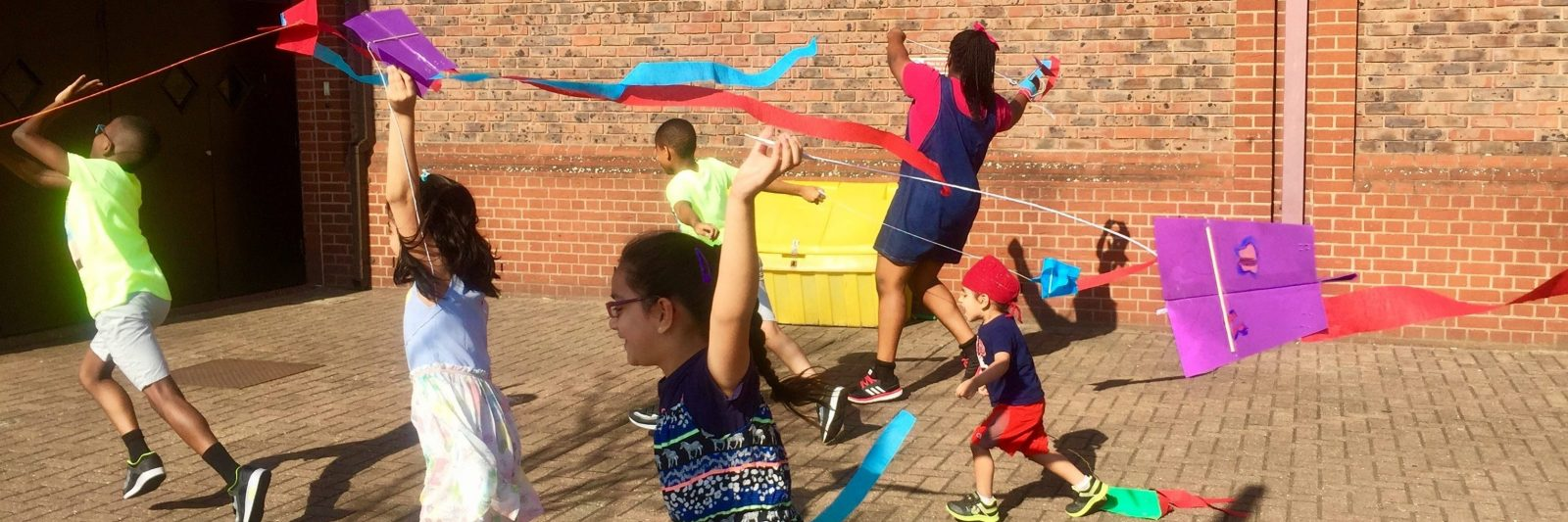 Children playing at Surrey Quays Shopping Centre with the kites they made at Crafty Beasts