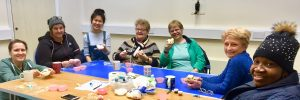 A group of community members enjoy crafting at Create Space